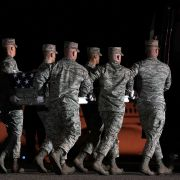 In this March 18, 2018, file image, members of the U.S. Air Force carry the flag-draped transfer case holding the remains of Air Force Master Sgt. Christopher Raguso of Commack, New York, at Dover Air Force Base in Delaware. Raguso was killed in a helicopter crash in western Iraq.
