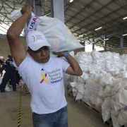 A volunteer helps stage U.S. humanitarian aid goods in Cucuta, Colombia, in preparation for an attempt to deliver them to Venezuela on Feb. 23.