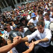 Juan Guaido, leader of the political opposition movement in Venezuela, greets supporters at a demonstration on May 1, 2019.
