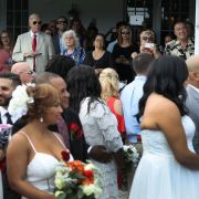 About 40 couples participate in a group Valentine's Day wedding ceremony on Feb. 14, 2017, in West Palm Beach, Florida.