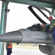 A pilot checks a F-16 during a drill at an air base in Taiwan
