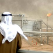In this January 2005 file image, a Kuwait Oil Company employee looks at a newly opened oil-gathering center north of Kuwait City.