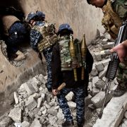 Iraqi troops clear house-by-house, moving toward the Old City in western Mosul on March 13.