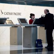 An employee of Cathay Pacific Airways helps a customer at Hong Kong's international airport on Aug. 7, 2018.