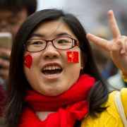 A demonstrator shows support for the Chinese government at a counterprotest held in response to an Amnesty International demonstration over human rights abuses and online censorship in China.