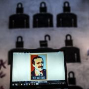 """A laptop screen in Istanbul shows an image of Turkish President Recep Tayyip Erdogan emblazoned with the slogan """"Yes We Ban,"""" a play on former U.S. President Barack Obama's campaign iconography."""