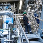Biotechnology engineer Jenny Pietzsch walks through a demo plant of the French company Global Bioenergies during its inauguration ceremony in Leuna, Germany, on May 11, 2017.