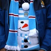 A fan of the Manchester City squad of the English Premier League shows off his festive spirit before a home match in December.