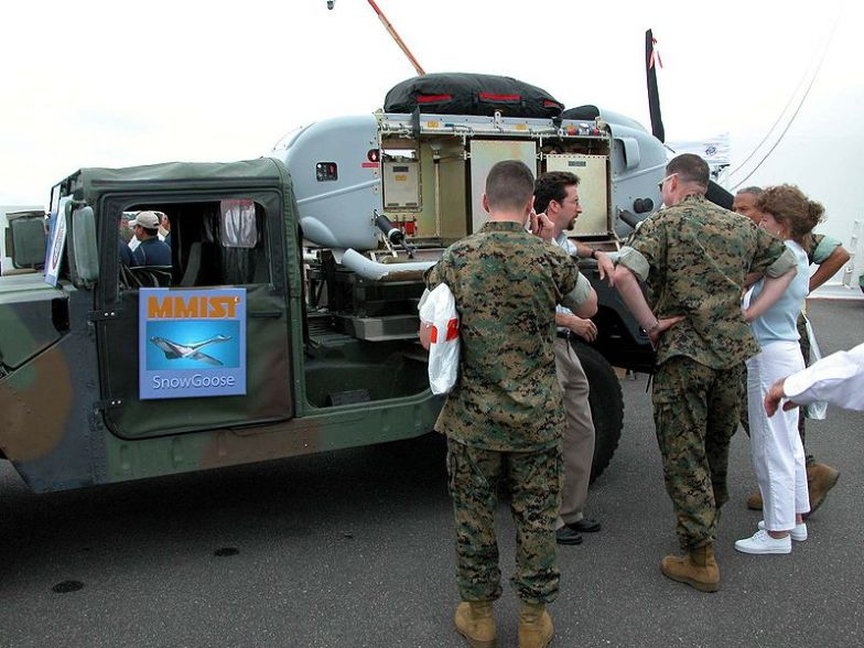 Sean McCann, a representative of Mist Mobility Integrated Systems Technology, tells Marines at the UAV flight demonstration site at Naval Air Station Patuxent River, Md., about his company's SnowGoose cargo drone.