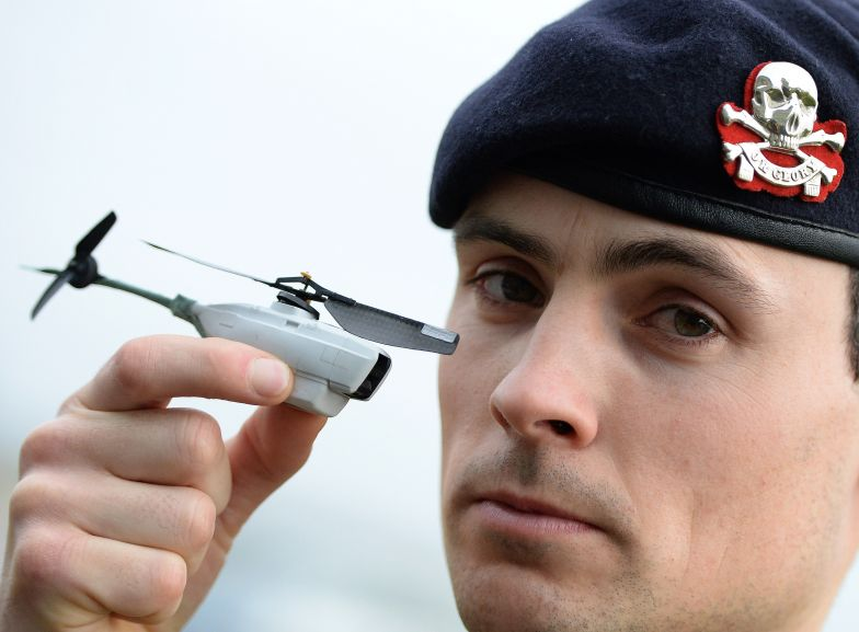 Sgt. Scott Weaver poses with a tiny unmanned Black Hornet drone, used by allied forces in Afghanistan, Oct. 15, 2014.