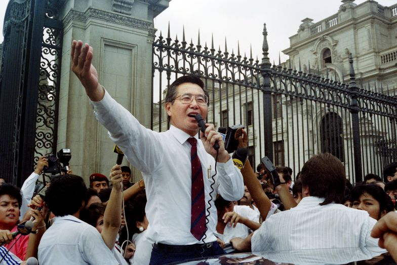 Peruvian President Alberto Fujimori addresses a crowd outside the government palace in Lim during a surprise public appearance in April, 1992.
