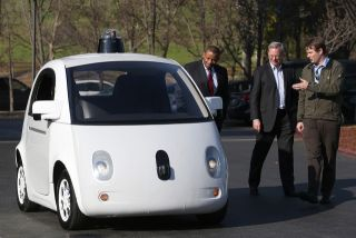Google's Chris Urmson (R) shows a Google self-driving car to U.S. Transportation Secretary Anthony Foxx (L) and Google Chairman Eric Schmidt (C) at Google headquarters in February in Mountain View, California.