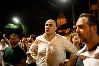 Tired protesters congregate in a square in Tbilisi.