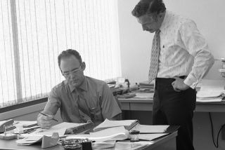 Intel co-founders Gordon Moore and Robert Noyce meeting in Intel's offices in 1970.