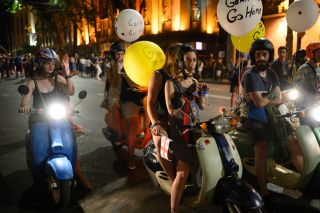 Protesters attached balloons with messages of resistance to their scooters.