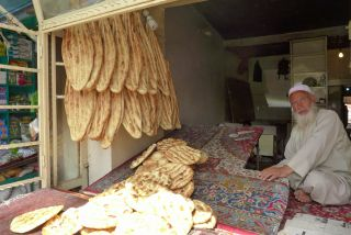 An Afghan baker sells traditional flat bread.