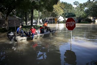 Residents in a neighborhood near the Barker Reservoir return to their homes on Aug. 31 to collect belongings.