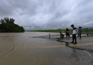 Local residents check the water level of the Barker Reservoir on Aug. 29 after the Army Corps of Engineers started to release water into the Clodine district to ease the heavy flooding in Houston.