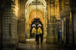 The Great Mosque in Cordoba integrates Byzantine mosaics with Gothic columns and Islamic arches.