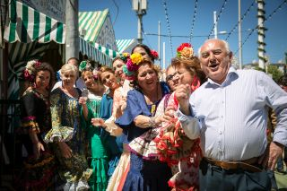 Revelers enjoy the festivities at Seville's Feria.