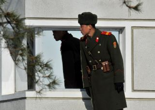 A North Korean soldier stands at a guard station in the Demilitarized Zone in early 2011.
