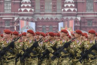 Russian soldiers march through Red Square in Moscow. The red color pictured here is representative of the National Guard of Russia.