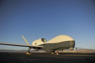 An RQ-4 Global Hawk unmanned aerial vehicle sits on the flight line.
