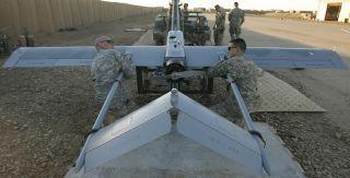 A U.S. Marine Corps RQ-7B Shadow unmanned aerial vehicle (UAV) prepares to land at Speedbag Airfield near Niland, California.
