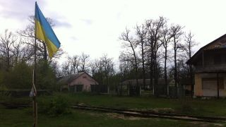 A Ukrainian flag flies in a rural village near Rivne, about 180 kilometers (112 miles) northeast of Lviv.