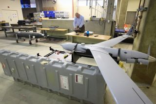 Student Derek Snyder, a major in the U.S. Marines, works on a prototype quadrotor unmanned aerial vehicle (UAV) in the Unmanned Systems Laboratory at the Naval Postgraduate School on Sept. 30, 2011, in Monterey, California.