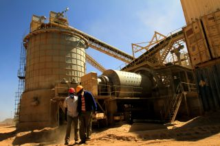 Workers stand at an Ariab gold mine in the Sudanese desert, located 800 kilometers (roughly 497 miles) northeast of Khartoum.