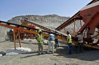 Employees work at a construction site for a new Chinese-built railway in Ethiopia on February 27, 2013. The new train line is one of eight new rail routes that will connect Ethiopia to neighboring countries, including Kenya, Sudan and South Sudan.