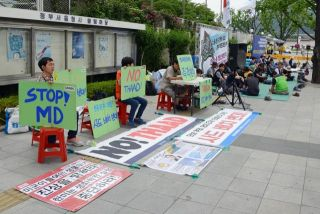 South Koreans outside of the U.S. Embassy in Seoul demonstrate against a proposed THAAD missile system. While South Korea relies on U.S. goodwill, it still occasionally tries to find ways to strengthen its own military, outward diplomacy and security.