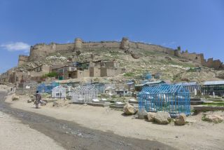 The legacy of a bygone era, a British fort overlooks a rural Afghan settlement.