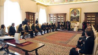 The pictures shows Italian President Sergio Mattarella speaking to Pope Francis during a visit at the Vatican.