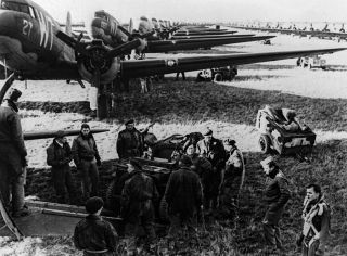 Allied aircrews work around C-47 transport planes at an unidentified English base in this photo taken shortly before the D-Day landings in Normandy, France.