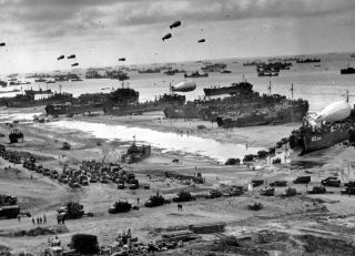 Photograph of D-Day landing craft, boats and seagoing vessels used to convey a landing force (infantry and vehicles) from the sea to the shore during an amphibious assault. Build-up of Allied forces landing at Omaha Beach, Normandy, France during the World War two D-Day landings 1944.