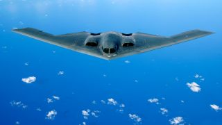 A B-2 Spirit from the 509th Bomb Wing at Whiteman Air Force Base, Mo., flies over the pacific ocean.