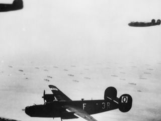 A photo of B-24 Liberators flying over the English Channel ahead of the Normandy Invasion.