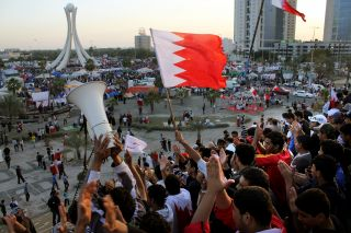 Anti-government protesters demonstrate at the Pearl Roundabout in Manama, Bahrain, on Feb. 20, 2011.