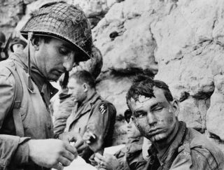 A picture shows wounded soldiers on a Normandy Beach, June 6, 1944.