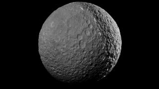 """Cassini made its closest approach to Saturn's pockmarked moon, Mimas -- nicknamed the """"Death Star""""-- on Jan. 30, 2017."""