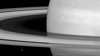 Cassini captured this shot of Saturn's rings, bands of icy particles spread over a vast area, with its wide-angle camera July 21, 2016. Mimas is visible on the bottom left.