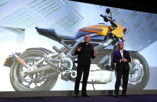 The vice president of consumer portfolio management at Harley-Davidson, Marc McCallister (left), talks about the the new Harley-Davidson LiveWire electric motorcycle with Panasonic North America Chairman and CEO Tom Gebhardt during a Panasonic event for CES 2019 at the Mandalay Bay Convention Center on Jan. 7 in Las Vegas.