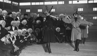 Cossacks perform a traditional dance involving daggers thrown from the mouth to stick in the floor in Holland Park, London, in December 1925.