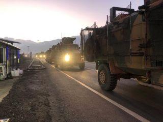 A Turkish military convoy moves through Kilis, Turkey, near the Syria border on Dec. 22, 2018.