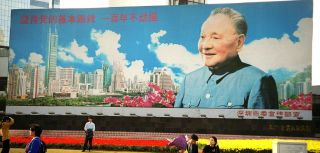 A billboard in Shenzhen depicts the late leader Deng Xiaoping, the architect of China's long-standing noninterventionist strategy.