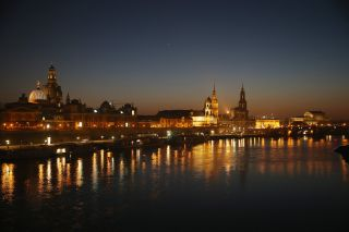 On Feb. 12, 2015, the Elbe River flows past Dresden's illuminated city center, much of which was obliterated by Allied bombing raids on Feb. 13, 1945 .