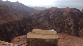 A Bedouin tent perched on a high point of Wadi Musa, next to the ancient Jordanian city of Petra.