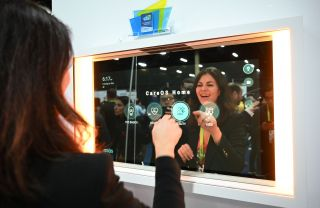 A vendor demonstrates the CareOS smart mirror at CES Unveiled, the preview event for CES 2019, on Jan. 6 in Las Vegas.